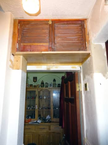Remodelled meter cupboard (before fresh application of wood stain), with new section added to wooden boxing just below the cupboard to hide and protect the mains power supply into the house