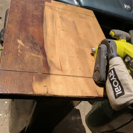 I started off by taking everything apart. I sanded down the table with a belt sander to remove the old stain, then smoothed out using a palm sander. I didn't have to use any varnish stripper for this one because the sanding did such a good job!
