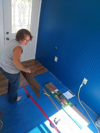 With the walls and ceiling freshly painted, we began to install the laminate flooring.