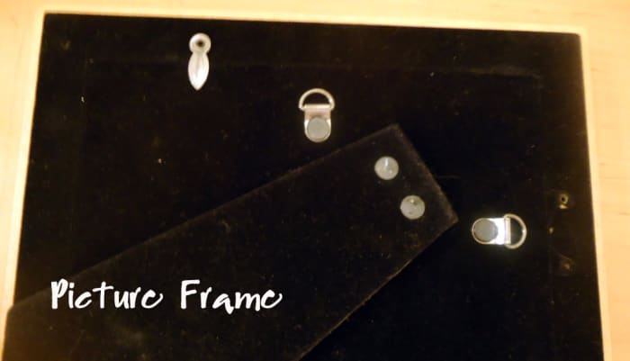 D type hanger is common on backs of picture frames.