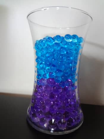 Colored layers of water beads.