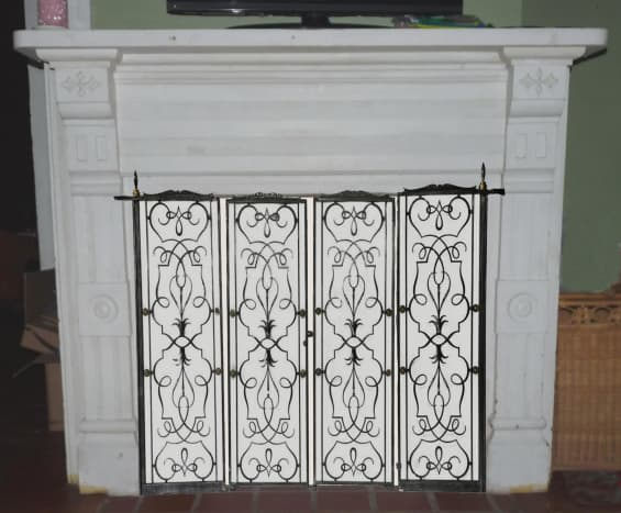 Art deco fireplace screen covering closed off fireplace