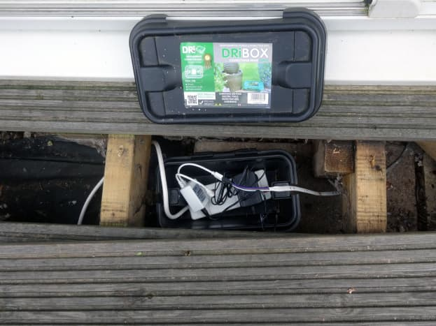 Weatherproof electric box placed under the decking.