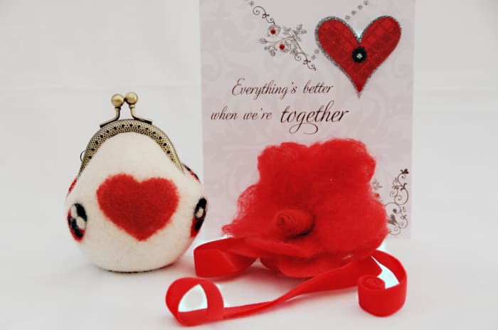 Needle felted heart on wet felted coin purse.