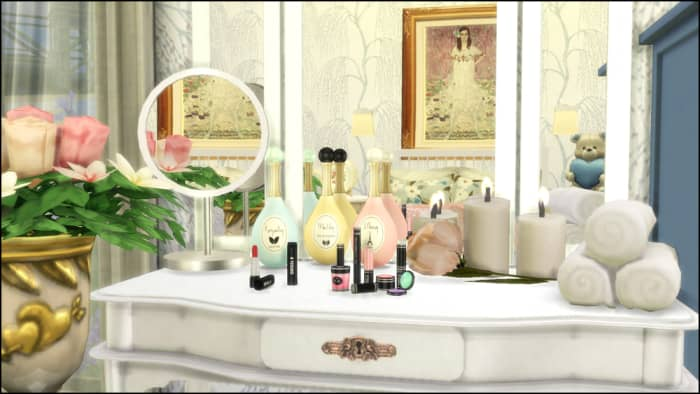 Your female Sim definitely needs this dainty set: makeup, perfume, and a vanity mirror.