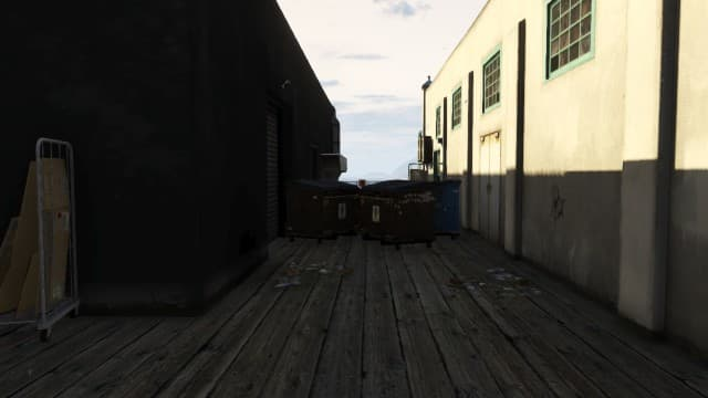 Use your Minigun to rearrange the dumpsters like this. It will hold off enemies coming from vehicles behind you.