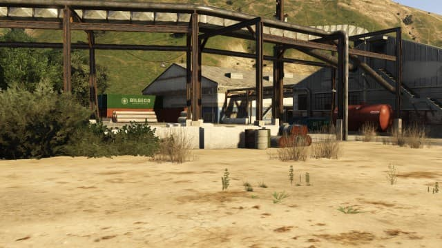 Take cover by these cement barriers when you get to the depot. Make use of the explosive obejects around the area.