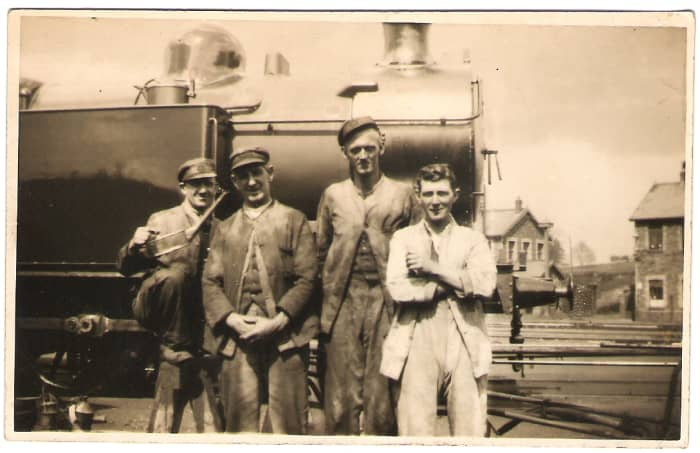 Loco cleaners pose on an engine at Caerphilly, Wales