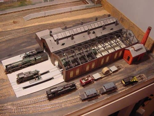 70K Coley Park shows various buildings in progress with track laid and rolling stock dispersed - ash-pits again (left) in front of shed entrance. Sand furnace (with chimney) below right