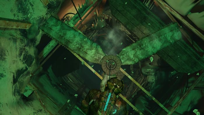 This is me, traversing down a shaft, with my rope stuck in a saw-blade fan about to get hacked to pieces.
