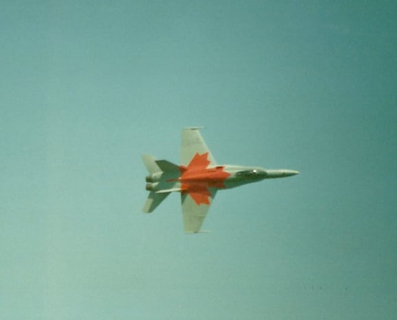 A Canadian Air Force C-188 with a red maple leaf painted on it.