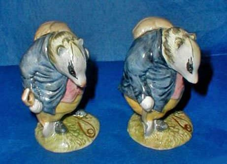 (Left) Beswick Beatrix Potter Tommy Brock BP 3a. (Right) Beatrix Potter Tommy Brock BP 3a—Very Rare Second Version, Handle Hidden, Small Eye Patch.