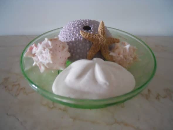 Here is side view of the cameo berry bowl.   I put some shells in it to give you an idea of depth.