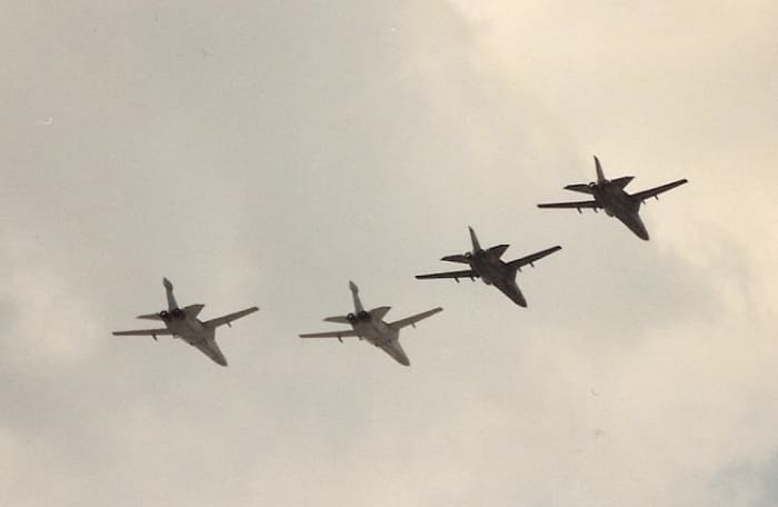 A flight of F-111s over Washington DC, June 1991.  It was part of the Desert Storm Victory Parade.  The 2 aircraft on the right are F-111s and the 2 on the left are EF-111s.