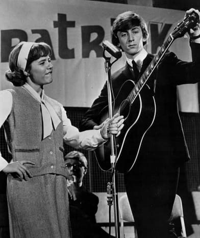 """High School Fashion in 1965: Patty Duke on her """"Patty Duke Show"""" about identical cousins and high school mates Patty and Cathy. Here, Patty is with Jeremy Clyde of the popular duo Chad and Jeremy in July, 1965."""