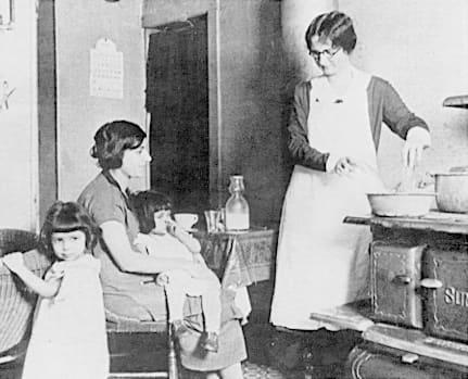 Woman wearing an apron circa 1918
