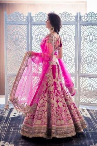 Fuchsia pink bridal lehenga.