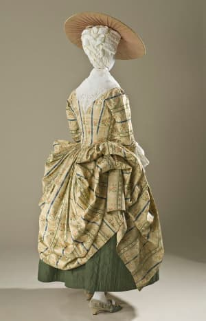 Polonaise style, circa 1775: shorter hemline and drawn-up over-dress.