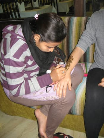 In Jaipur, India, I sit patiently as elaborate henna is drawn onto my arm.