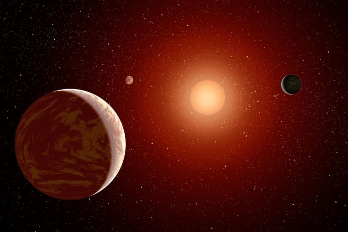 Artists conception of Gliese 163 and surrounding planets.