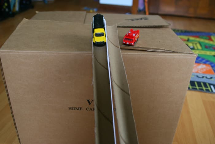 Cut a long cardboard tube in half and have side-by-side car races.