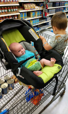The baby can ride directly in the hammock, or by hooking the carseat into the hammock. This allows for more room in the cart for both kids, as well as groceries!