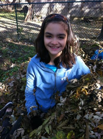 Jumping in the leaves is a fun fall activity for kids of all ages.