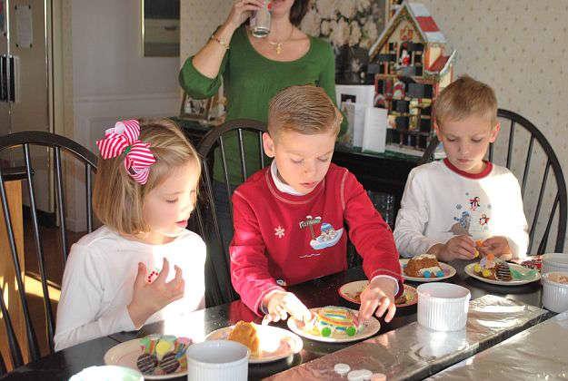 Cousins making a cake train