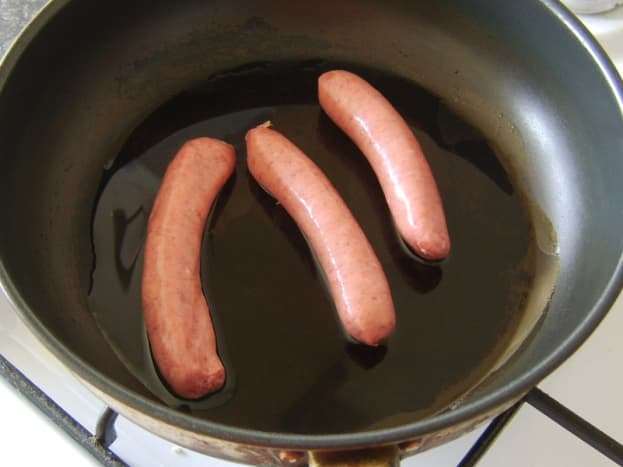 The sausages have to go in to the pan first.