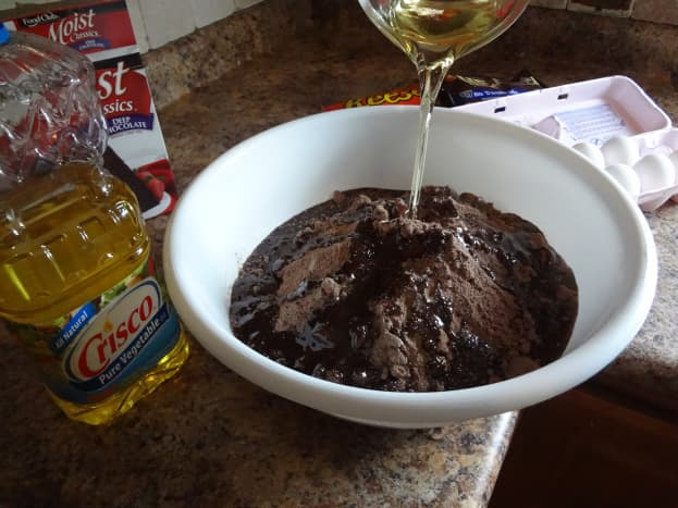 Combine the cake mix and the oil.