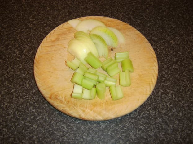 Onion and celery prepared for soup pot