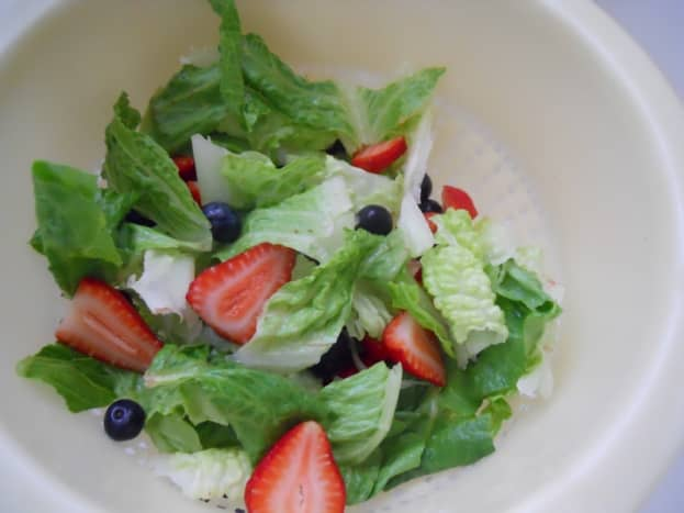 Rinse and drain greens and berries.
