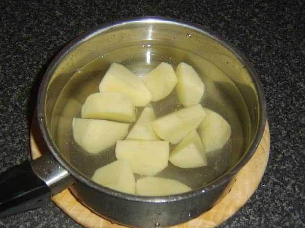 Chopped potatoes ready for boiling