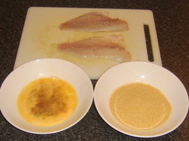 Preparing sea bream fillets for pan frying in breadcrumbs