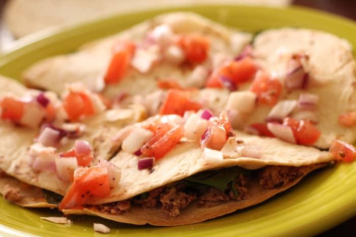 A simple fresh salsa accompanying a bean and vegetable quesadilla.