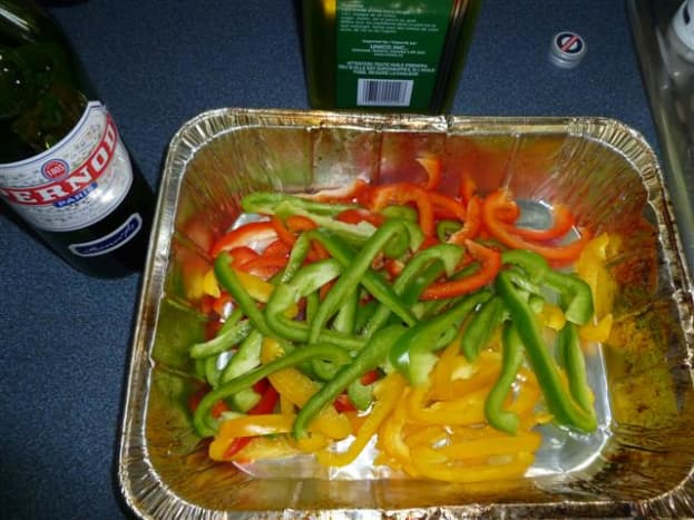 Toss the thinly sliced peppers into a bbq-safe roasting pan...a disposable aluminium one works great.