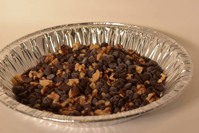 Mix the chocolate chips, mint chips, and chopped walnuts in a flat dish and set aside.