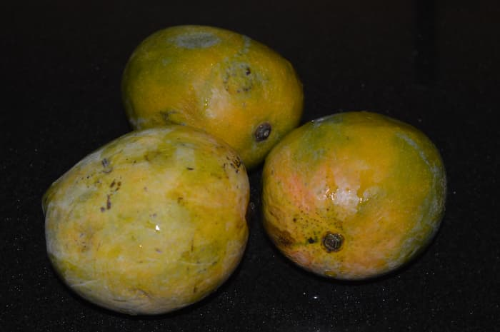 Step one: Wash mangoes and chop them