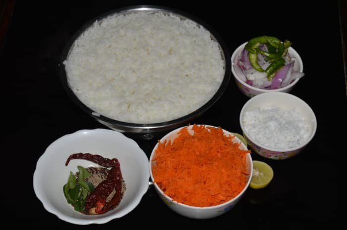 Step one: Keep the ingredients ready. Immerse cooked rice on a plate.