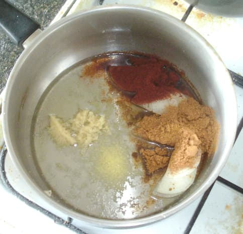 Onion, garlic and spices are added to hot sunflower oil
