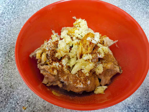 In a bowl, add chicken, yogurt, ginger-garlic paste and all of the dry spices.