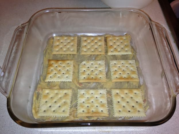 The first layer of crackers.