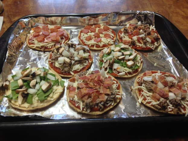 Mini Pizzas made on round flatbreads, ready for oven