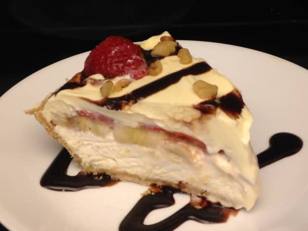 Banana Split Pie with cream cheese, fresh fruit, and pudding layers