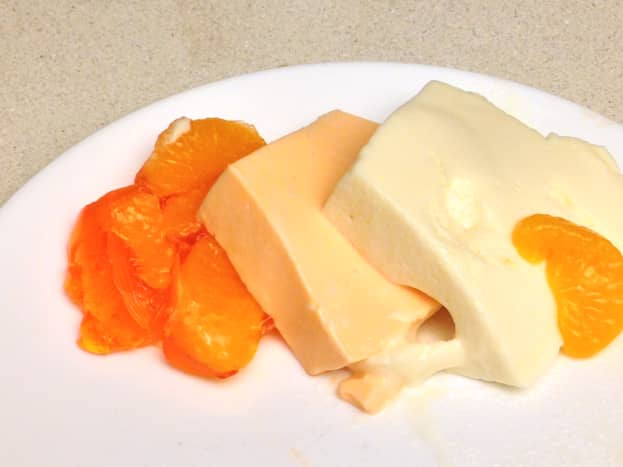 Mandarin Orange Gelatin Dessert with Lemon Fluff layer.  As you can see the layers slide off of each other.