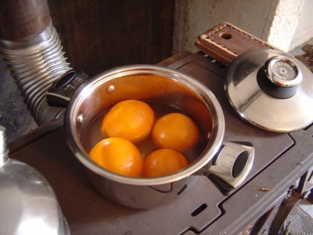Simmer oranges in water for an hour