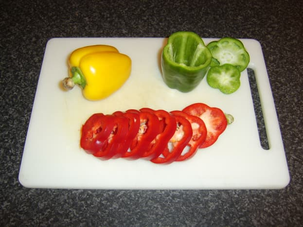 Slice the bell peppers and cut seeds and core from each slice, or core and then slice