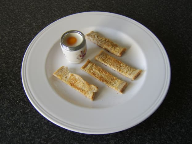 Coddled eggs and toasted soldiers