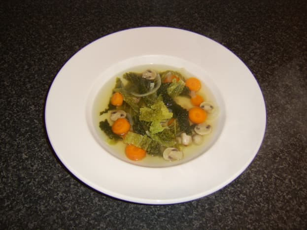 This simple quail stock, savoy cabbage and root vegetable soup makes an excellent winter starter for a meal.