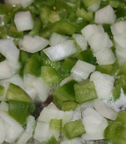 Sautee chopped onion and pepper in oil & let it cool before gently mixing it into the seasoned crab meat mixture.